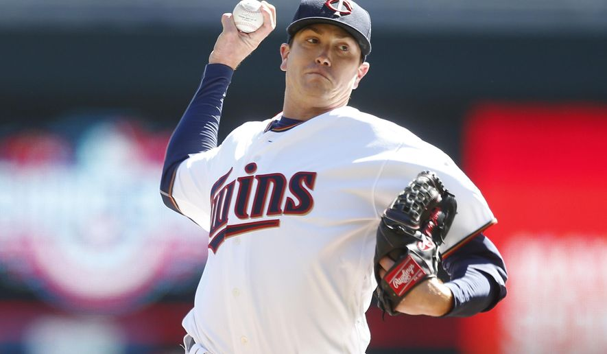 Minnesota Twins pitcher Kyle Gibson throws against the Kansas City Royals in the first inning of a baseball game Thursday, April 6, 2017, in Minneapolis. (AP Photo/Jim Mone)