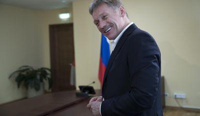 President Vladimir Putin's spokesman Dmitry Peskov speaks with The Associated Press in Moscow, Russia, Thursday, April 6, 2017. (AP Photo/Pavel Golovkin)