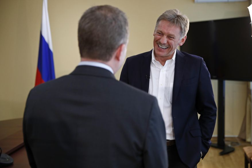 President Vladimir Putin's spokesman Dmitry Peskov, right, speaks with Ian Phillips, vice president International News Associated Press, during a meeting with The Associated Press in Moscow, Russia, Thursday, April 6, 2017.  Peskov told The Associated Press that Russia's support for Syrian President Bashar Assad is not unconditional, with Putin's Spokesman talking just days after a suspected chemical weapons attack on a Syrian rebel-held province.(AP Photo/Pavel Golovkin)