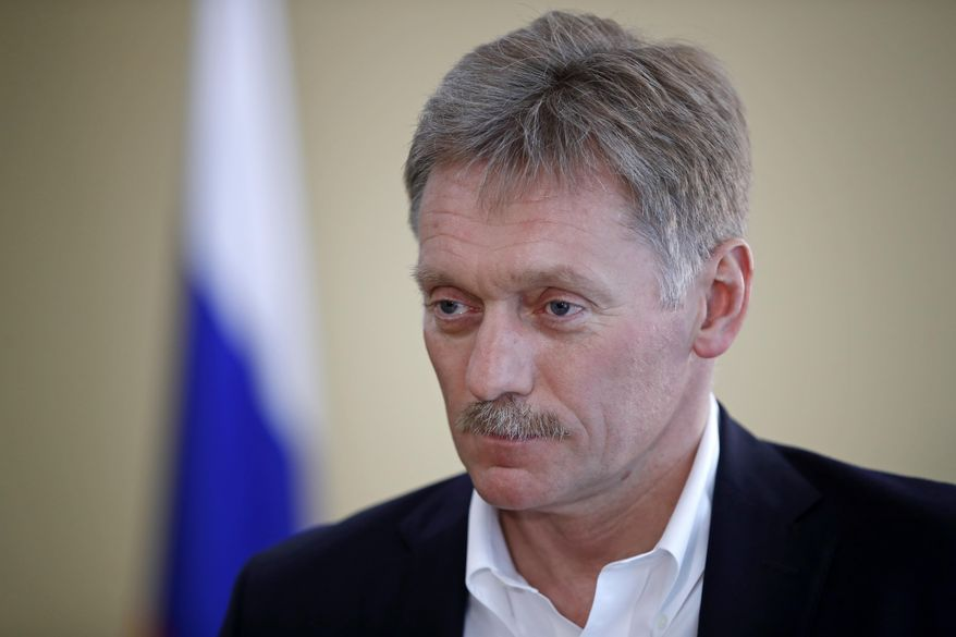 President Vladimir Putin's spokesman Dmitry Peskov speaks with The Associated Press in Moscow, Russia, Thursday, April 6, 2017.  Peskov tells The Associated Press that Russia's support for Syrian President Bashar Assad is not unconditional, with Putin's Spokesman talking just days after a suspected chemical weapons attack on a Syrian rebel-held province.(AP Photo/Pavel Golovkin)