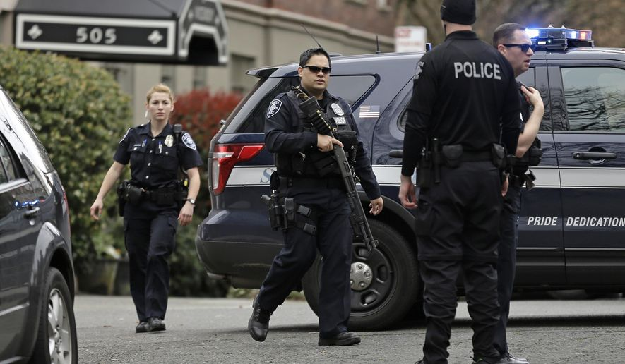 In this photo taken March 2, 2016, Seattle Police officers respond to a call of an armed man barricaded in his apartment in Seattle. Police, including several members of SPD's crisis response unit, were able to resolve the situation peacefully. A new report from a court-appointed monitor released Thursday, April 6, 2017, says that the use of serious levels of force by Seattle police is down 60 percent since the federal government imposed reforms on the department. (AP Photo/Ted S. Warren)