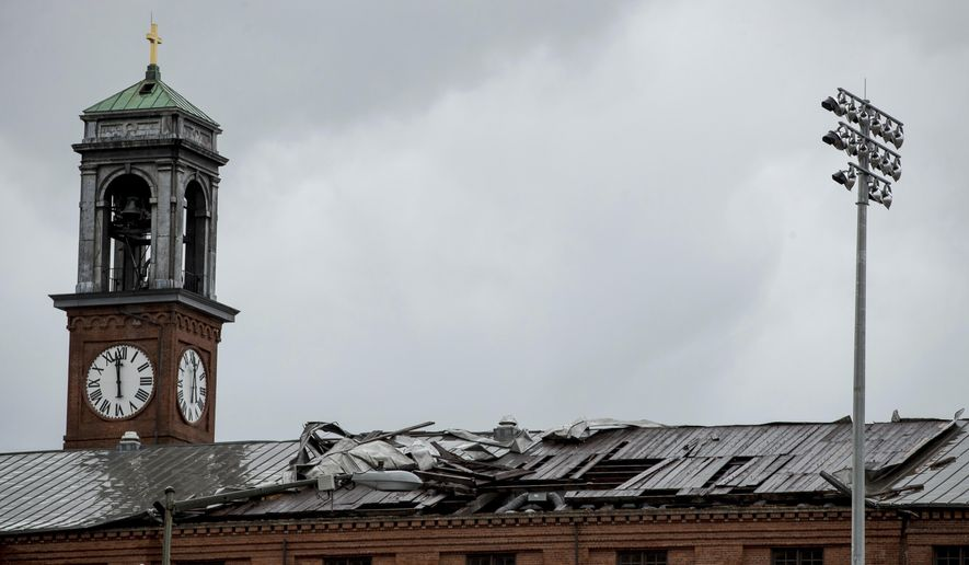 The damaged the roof of St. Aloysius Catholic Church at Gonzaga High School in Washington, Thursday, April 6, 2017. Buildings were damaged in the Washington area as rough weather moved through. (AP Photo/Andrew Harnik)Photo/Andrew Harnik)