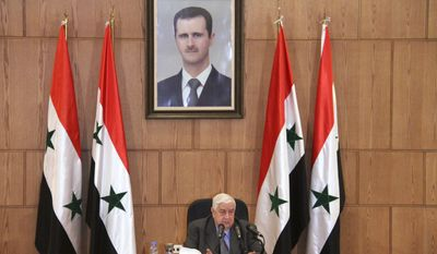 In this photo released by the Syrian official news agency SANA, Syrian Foreign Minister Walid Moallem, speaks during a press conference, Thursday, April 6, 2017, in Damascus, Syria. Moallem told reporters Thursday that it didn't use chemical weapons in Tuesday's deadly chemical weapons attack in Syria's northern Idlib province, and he blamed the rebels for stockpiling the deadly substance. Moallem said any investigative mission would need to take off from Damascus and be far from the sphere of Turkish influence. (SANA via AP)