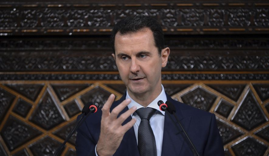 In this June 7, 2016, file photo released by the Syrian official news agency SANA, Syrian President Bashar Assad, addresses a speech to the newly elected parliament at the parliament building, in Damascus, Syria. (SANA via AP)