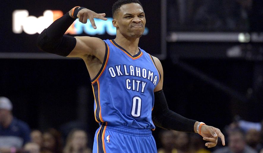 Oklahoma City Thunder guard Russell Westbrook (0) gestures after scoring a 3-pointer during the second half of the team's NBA basketball game against the Memphis Grizzlies Wednesday, April 5, 2017, in Memphis, Tenn. (AP Photo/Brandon Dill)