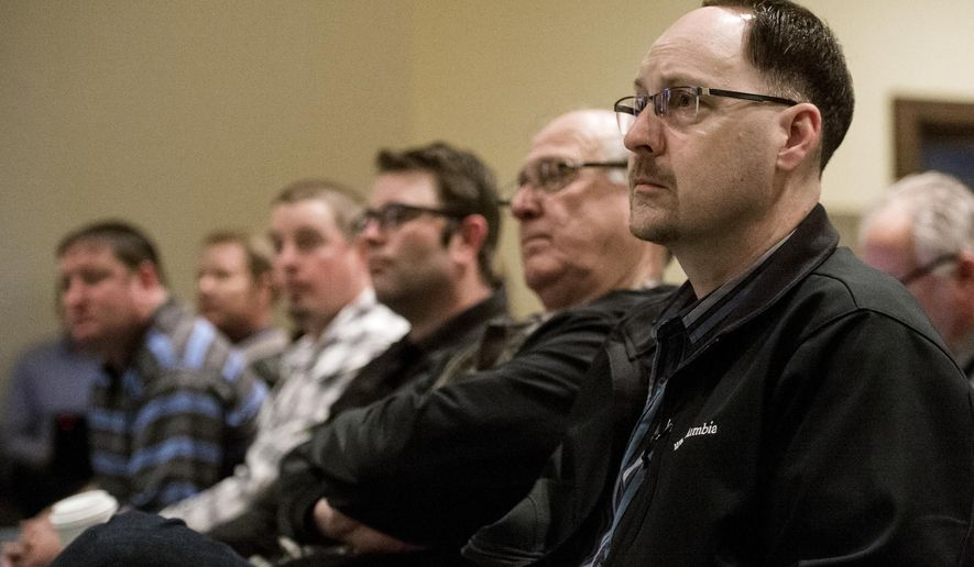 Owners of Whiteclay's four beer stores listen to testimony before the Nebraska Liquor Control Commission during a hearing regarding alcohol sales in Whiteclay, Neb., on Thursday, April 6, 2017, at the Nebraska Capitol in Lincoln, Neb. The stores in Whiteclay are blamed for rampant alcoholism on the neighboring Pine Ridge Indian Reservation in South Dakota. (Kristin Streff/The Journal-Star via AP, Pool)