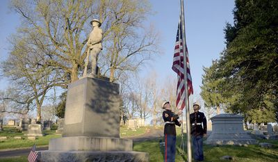 United State Marine Corp Staff Sgt. Kevin Harmon, left, and Pfc. David Aguirre raise the flag at Mount Mora Cemetery Thursday, April 6, 2017, in St. Joseph, Mo. They also laid a wreath at the World War I memorial in honor of the 100th anniversary of the United States entering the first world war. (Jessica A. Stewart/The St. Joseph News-Press via AP)