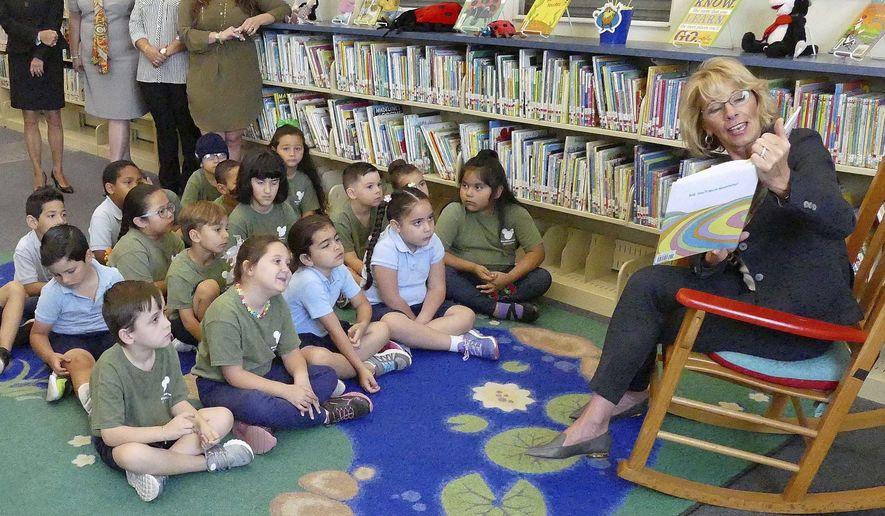 Secretary of Education Betsy DeVos reads Dr. Seuss to Kindergarten students at Royal Palm Elementary School in Miami on Friday, April 7, 2017.   (C.M. Guerrero/El Nuevo Herald via AP)