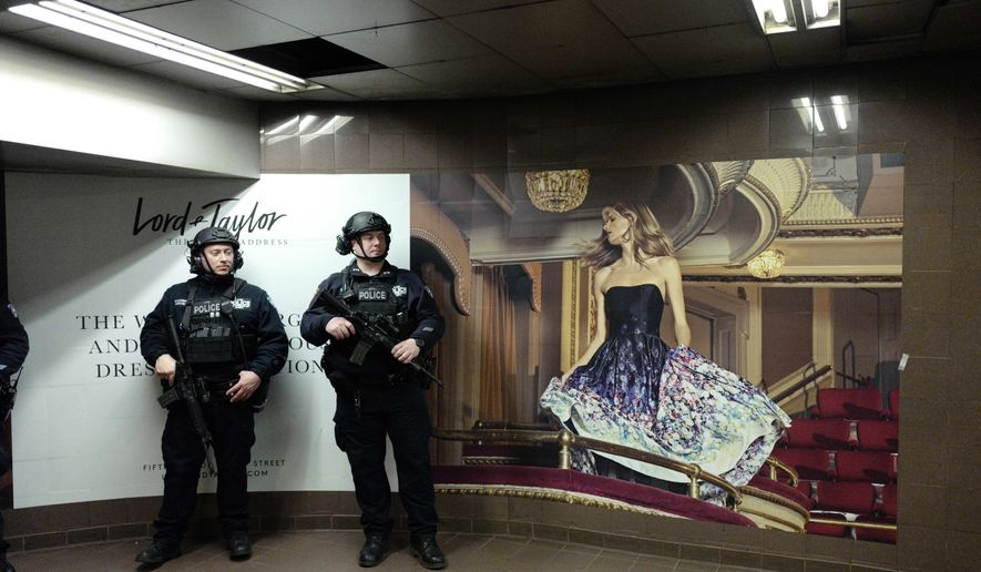 Police officers guard a subway entrance in Grand Central Terminal, Friday, April 7, 2017 in New York. The city police are on alert following the United States' missile strike early Friday against a Syrian airfield. (AP Photo/Mark Lennihan)