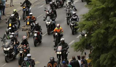 Demonstrators on motorbikes protest against South African President Jacob Zuma in Pretoria, South Africa, Friday, April 7, 2017. South Africans are gathering for nationwide demonstrations against Zuma, whose dismissal of the finance minister fueled concerns over government corruption and economic weakness. (AP Photo/Themba Hadebe)