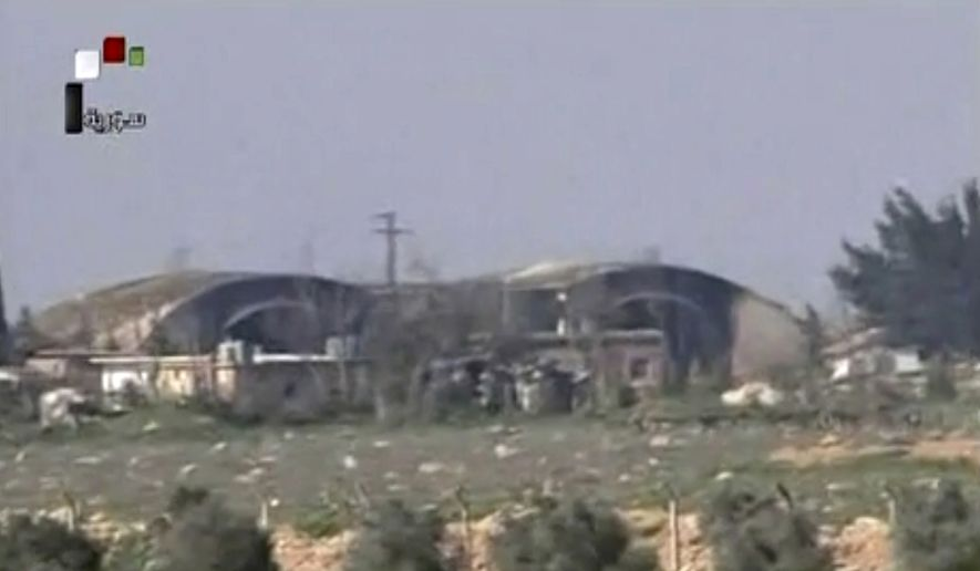 This frame grab from video provided by the Syrian official TV, a Syrian government channel that is consistent with independent AP reporting, shows the burned and damaged hangar warplanes which attacked by U.S. Tomahawk missiles, at the Shayrat Syrian government forces airbase, southeast of Homs, Syria, Friday April, 7, 2017. (Syrian government TV, via AP)