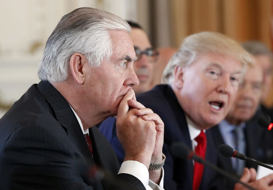 Secretary of State Rex Tillerson, left, listens as President Donald Trump speaks during a bilateral meeting with Chinese President Xi Jinping at Mar-a-Lago, Friday, April 7, 2017, in Palm Beach, Fla.  (AP Photo/Alex Brandon) **FILE**