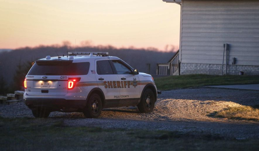 Investigators are work the scene in rural Bondurant, Iowa, where three bodies were found in a home overnight on Friday, April 7, 2017.  Deputies are searching for a man as a person of interest but who has not been charged.  (Bryon Houlgrave/The Des Moines Register via AP  )
