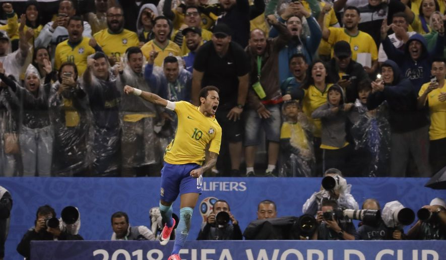 "FILE - In this March 28, 2017 file photo, Brazil's Neymar celebrates scoring his side's 2nd goal against Paraguay during a 2018 World Cup qualifying soccer match at the Arena Corinthians Stadium in Sao Paulo, Brazil. Neymar called Brazil the best team in the world a few weeks ago. His coach returned the compliment on Friday, April 7, 2017, and called the Brazilian striker the ""best"" in the game if you look at the last few months. (AP Photo/Andre Penner, File)"