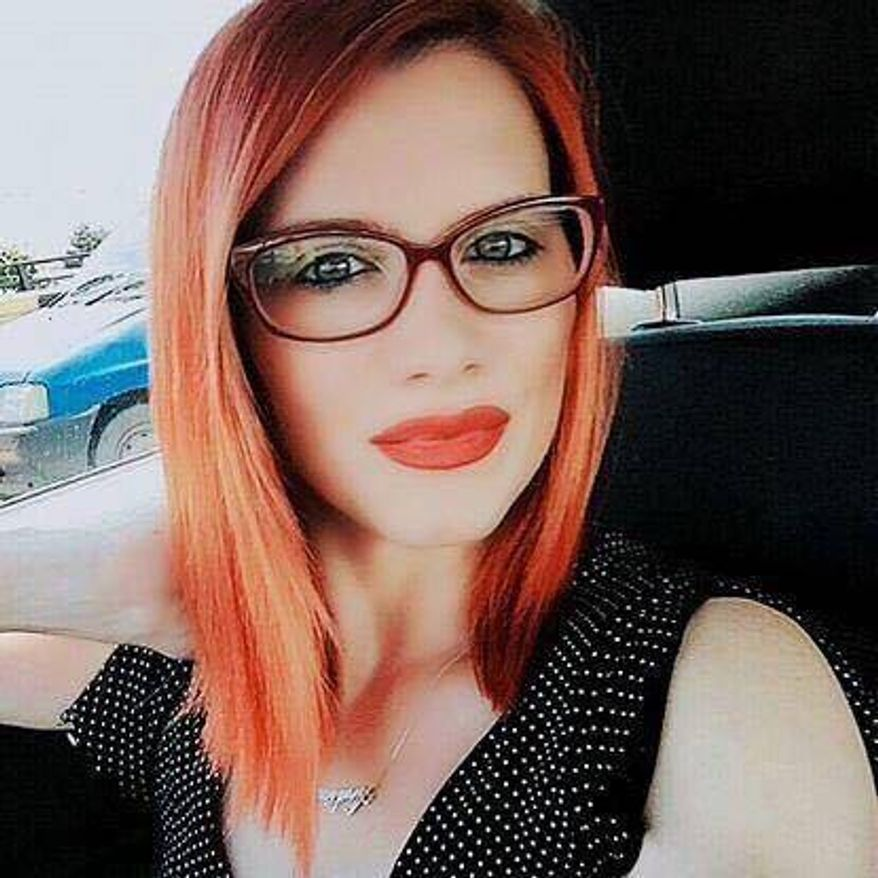 Image released through the Metropolitan Police on Friday April 7, 2017 of Andreea Cristea. Cristea, a 31-year-old Romanian tourist who was knocked into the River Thames from Westminster Bridge during an attack on Britain's Houses of Parliament more than two weeks ago has died, London police said Friday. (Metropolitan Police via AP)