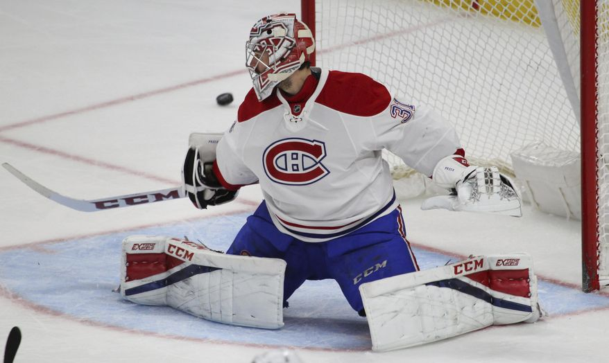 Montreal Canadiens goalie Carey Price (31) deflects the puck into the Corner during the third period of an NHL hockey game against the Buffalo Sabres, Wednesday, April 5, 2017, in Buffalo, N.Y. (AP Photo/Jeffrey T. Barnes)