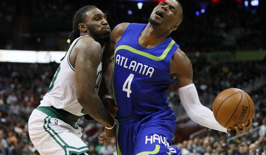 Atlanta Hawks forward Paul Millsap (4) is fouled by Boston Celtics forward Jae Crowder (99) in the second half of an NBA basketball game on Thursday, April 6, 2017, in Atlanta. The Hawks won the game 123-116. (AP Photo/Todd Kirkland)