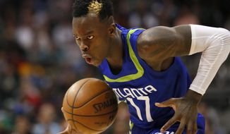 Atlanta Hawks guard Dennis Schroder (17) drives tot he basket in the second half of an NBA basketball game against the Boston Celtics on Thursday, April 6, 2017, in Atlanta. The Hawks won the game 123-116. (AP Photo/Todd Kirkland)