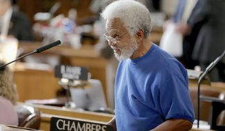 In this Jan. 25, 2017, photo, State Sen. Ernie Chambers of Omaha, works in the Legislative Chamber in Lincoln, Neb. The Legislature's Executive Board has decided to dismiss a residency challenge against the state's longest-serving state senator by John Sciara, a political opponent who challenged and lost to Chambers in the November election. (AP Photo/Nati Harnik)