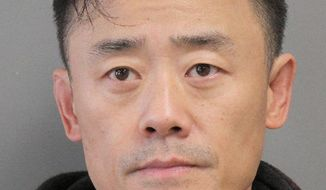 "This Jan. 19, 2017 photo provided by the Nassau County Police Dept. shows a booking photo of Chinese comedian Zhou Libo taken in Mineola, N.Y., after his arrest on weapon and drug possession charges. Zhou, 49, a former judge on the ""China's Got Talent"" television program, has pleaded not guilty to charges stemming from his arrest in the village of Lattingtown, N.Y., where police officers stopped the black Mercedes he was driving shortly after midnight because they said he had been driving erratically. (Nassau County Police Dept. via AP)"