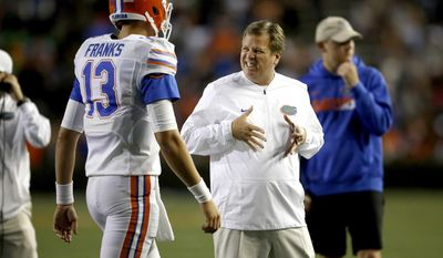 Florida coach Jim McElwain gestures to quarterback Feleipe Franks (13) after a poor throw by Franks during the NCAA college football team's spring game Friday, April 7, 2017, in Gainesville, Fla. (Brad McClenny/The Gainesville Sun via AP)