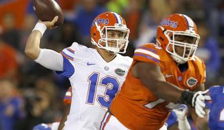 Florida quarterback Feleipe Franks (13) throws a pass during the NCAA college football team's spring game Friday, April 7, 2017, in Gainesville, Fla. [Brad McClenny/The Gainesville Sun via AP)