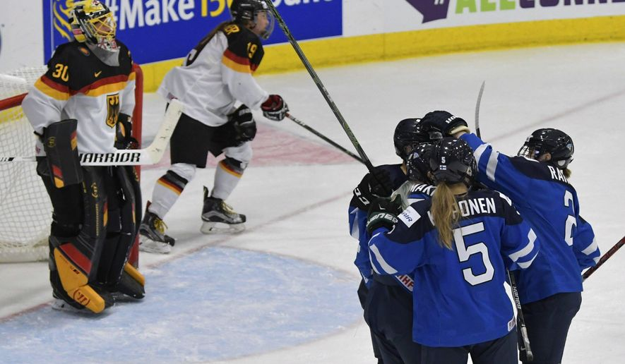 Finland players celebrate a first period goal by Venla Hovi (9) during the bronze medal game against Germany in the women's ice hockey world championships in Plymouth, Mich., Friday, April 7, 2017. (Jason Kryk/The Canadian Press via AP)