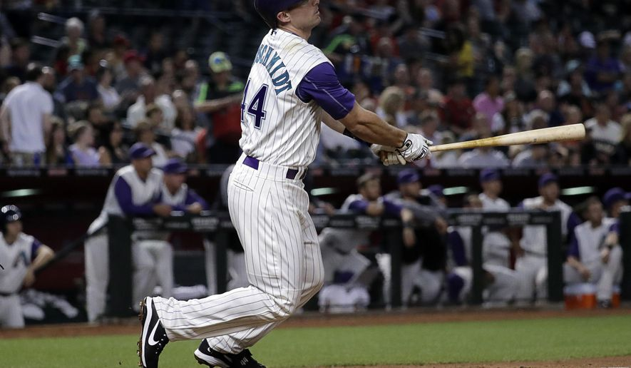 Arizona Diamondbacks' Paul Goldschmidt follows through on a solo home run against the San Francisco Giants during the fourth inning of a baseball game, Thursday, April 6, 2017, in Phoenix. (AP Photo/Matt York)