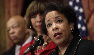 In this Jan. 12, 2017, file photo, Attorney General Loretta Lynch, right, speaks during a joint news conference in Baltimore. Ms. Lynch is set to testify before Congress regarding Russian meddling in the 2016 presidential election. (AP Photo/Patrick Semansky, File)