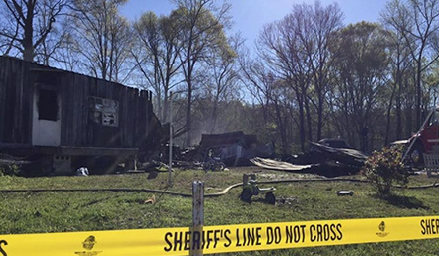 This photo provided by Cassie Walsh, of WMFU Radio, shows the remains of a house that caught fire killing five family members in the early morning hours Friday, April 7, 2017, in Buchanan, Tenn. A young teenager saved her little sister's life in the overnight house fire that killed their parents and three siblings, a Tennessee sheriff said Friday. (Cassie Walsh/WMUF Radio via AP)