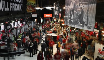 In this Sunday, March 26, 2017, photo, Detroit Red Wings fans enter Joe Louis Arena past a statue of Gordie Howe before an NHL hockey game in Detroit. Joe Louis Arena will be the home of the Red Wings one more time on Sunday, April 9, when they host the New Jersey Devils. The game will mark the end of the era at a storied arena, where the Red Wings have hoisted four of their 11 Stanley Cup banners to the crowded rafters where all-time greats such as Gordie Howe and Steve Yzerman have their retired jerseys hanging. (AP Photo/Paul Sancya)