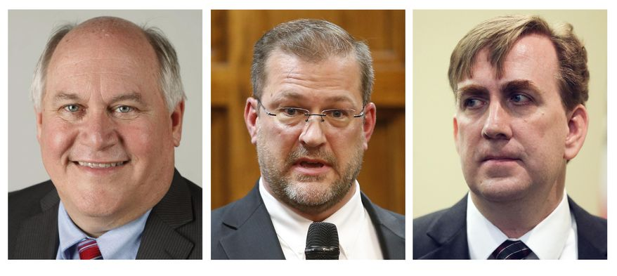 The combination of photos shows the candidates running in the April 11, 2017 special general election in Kansas' 4th Congressional District to replace former GOP Rep. Mike Pompeo, who was appointed director of the Central Intelligence Agency. They are from left: Republican Ron Estes, a former state treasurer; Democrat James Thompson, a civil rights attorney; and Libertarian Chris Rockhold, a flight instructor. (The Wichita Eagle via AP)