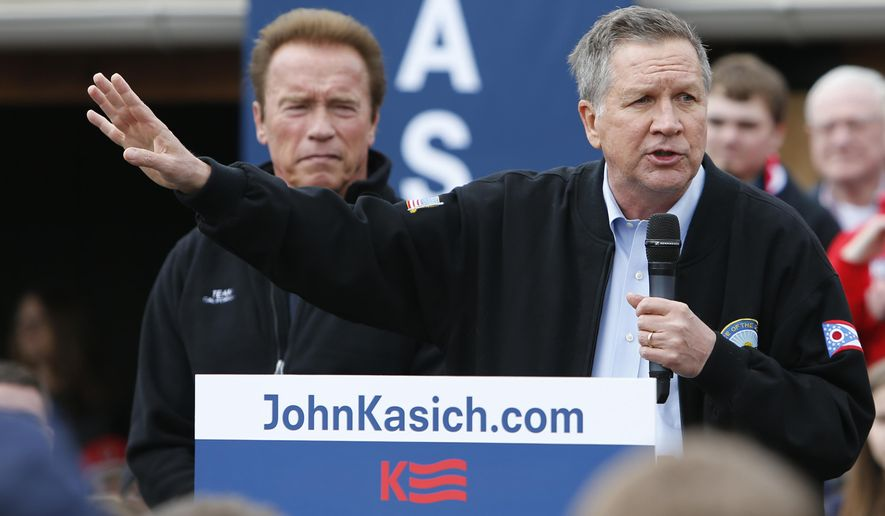 FILE - In this Sunday, March 6, 2016 file photo, Republican presidential candidate, Ohio Gov. John Kasich, speaks during a campaign rally accompanied by former California Gov. Arnold Schwarzenegger in Columbus, Ohio. In a Los Angeles Times interview published Wednesday, April 5, 2017, Schwarzenegger says Kasich should run again for the White House in 2020, effectively endorsing a primary challenge to President Donald Trump. (AP Photo/Jay LaPrete)