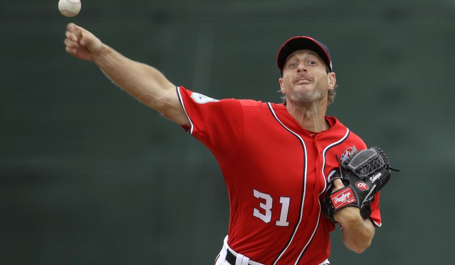 FILE - In this April 1, 2017, file photo, Washington Nationals starting pitcher Max Scherzer throws to the Boston Red Sox during an exhibition baseball game at the U.S. Naval Academy in Annapolis, Md. Scherzer takes the mound for Washington against the Phillies in the latter's home opener Friday. (AP Photo/Patrick Semansky, File)