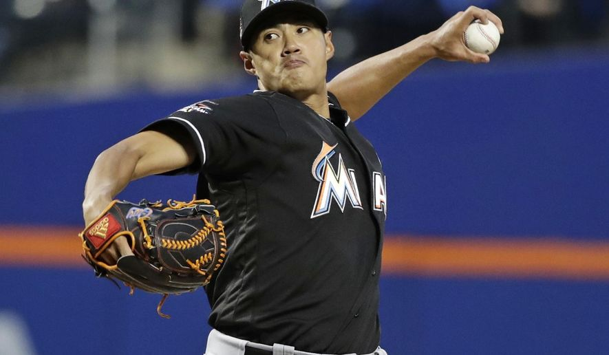 Miami Marlins starting pitcher Wei-Yin Chen throws during the first inning of the team's baseball game against the New York Mets on Friday, April 7, 2017, in New York. (AP Photo/Frank Franklin II)