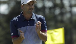 Sergio Garcia, of Spain, claps after putting on the 18th green during the second round of the Masters golf tournament Friday, April 7, 2017, in Augusta, Ga. (AP Photo/David J. Phillip)