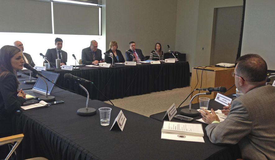 Members of Ohio's Medical Marijuana Advisory Committee discuss proposed rules for implementing the state's medical cannabis program during a Friday, April 7, 2017, meeting at the Vern Riffe Center for Government and the Arts in Columbus, Ohio. A public comment period on strict new rules proposed for the use of medical marijuana in Ohio was also set to conclude on Friday.  (AP Photo/Julie Carr Smyth)
