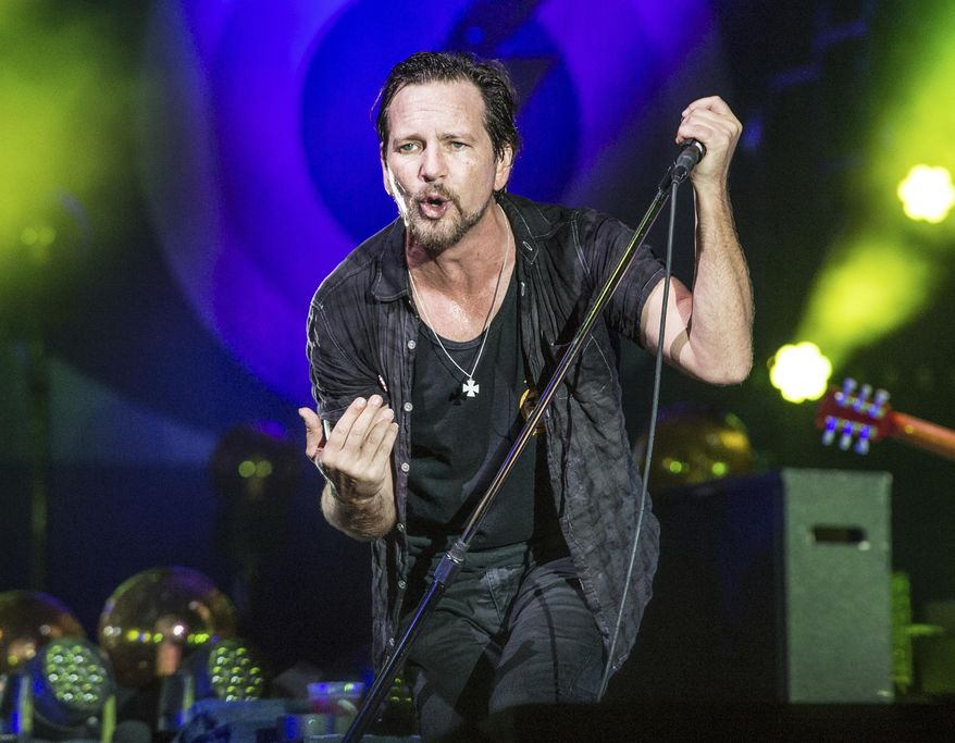 FILE - In this June 11, 2016 file photo, Eddie Vedder of Pearl Jam performs at Bonnaroo Music and Arts Festival in Manchester, Tenn. Pearl Jam, Tupac Shakur, Joan Baez, Electric Light Orchestra, Journey and Yes will be inducted into the Rock and Roll Hall of Fame on Friday, April 7, 2017. (Photo by Amy Harris/Invision/AP, File)