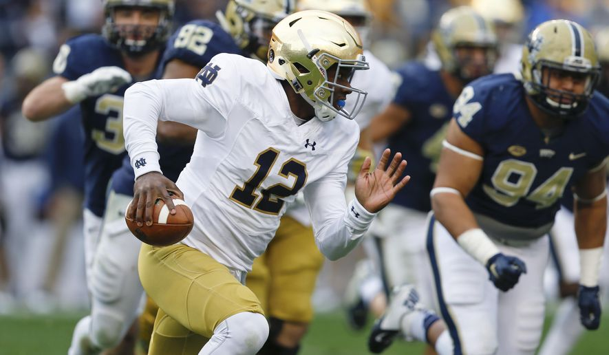 FILE - In this Nov. 7, 2015, file photo, Notre Dame quarterback Brandon Wimbush (12) carries during the team's NCAA college football game against Pittsburgh in Pittsburgh. Wimbush, the third-year sophomore tasked with resuscitating the Fighting Irish after a 4-8 season, spent most of his first season preparing to be just one snap away from taking over a team that was fighting for a College Football Playoff spot until the very last play of its regular season. He spent his second year redshirting, relegated to sideline duty as Notre Dame stumbled to a tumultuous 2016 campaign that has left everyone on notice entering 2017. (AP PhotoKeith Srakocic, File)
