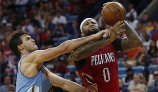 New Orleans Pelicans forward DeMarcus Cousins (0) is fouled as he drives to the basket against Denver Nuggets forward Danilo Gallinari in the second half of an NBA basketball game in New Orleans, Tuesday, April 4, 2017. The Nuggets won 134-131. (AP Photo/Gerald Herbert)