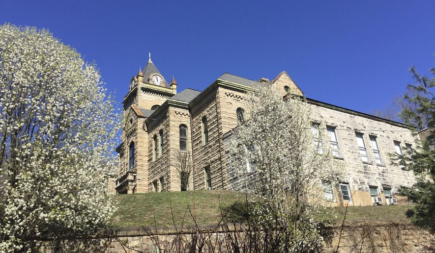 In this March 12, 2017 photo, The McDowell County Courthouse is seen, in Welch, W.Va. Mayor Reba Honacker filed a lawsuit in February 2017, at the McDowell County Courthouse, two blocks from her office in Welch, West Virginia, against five of the largest U.S. painkiller distributors. She wants them to answer for profiting from the region's opioid epidemic fueled by excessively large pill shipments over a decade and then use any proceeds to establish a local drug-rehabilitation center. (AP Photo/S.M. Christman)