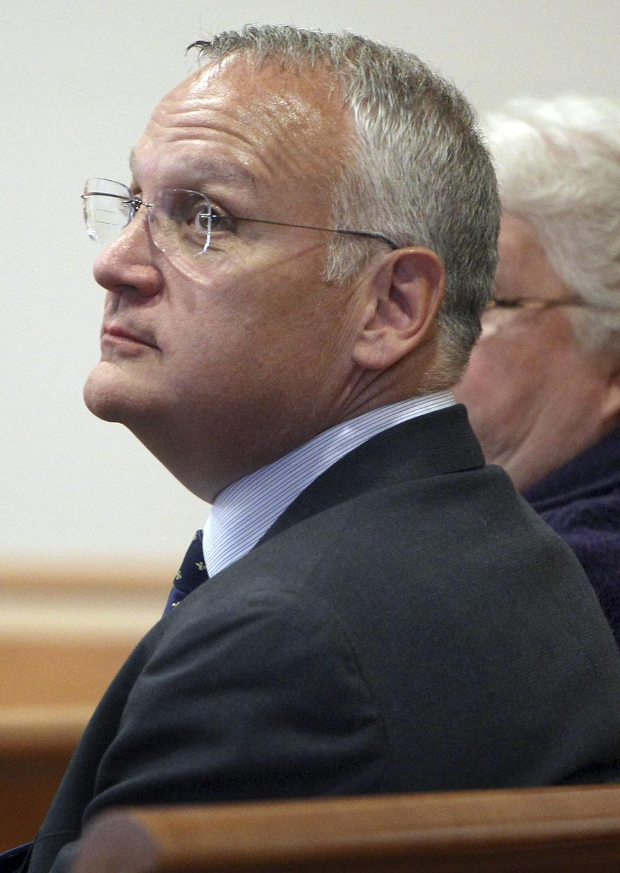 FILE - In this April 23, 2014 file photo, Monsignor Edward Arsenault looks back before pleading guilty to three felony theft charges in Hillsborough County Superior court in Manchester, N.H. The Diocese of Manchester said Friday, April 7, 2017, that Pope Francis dismissed Arsenault from the priesthood on Feb. 28. Arsenault is serving a jail sentence after he was convicted of stealing thousands of dollars from a hospital, a bishop and a deceased priest's estate. (AP Photo/Jim Cole, File)