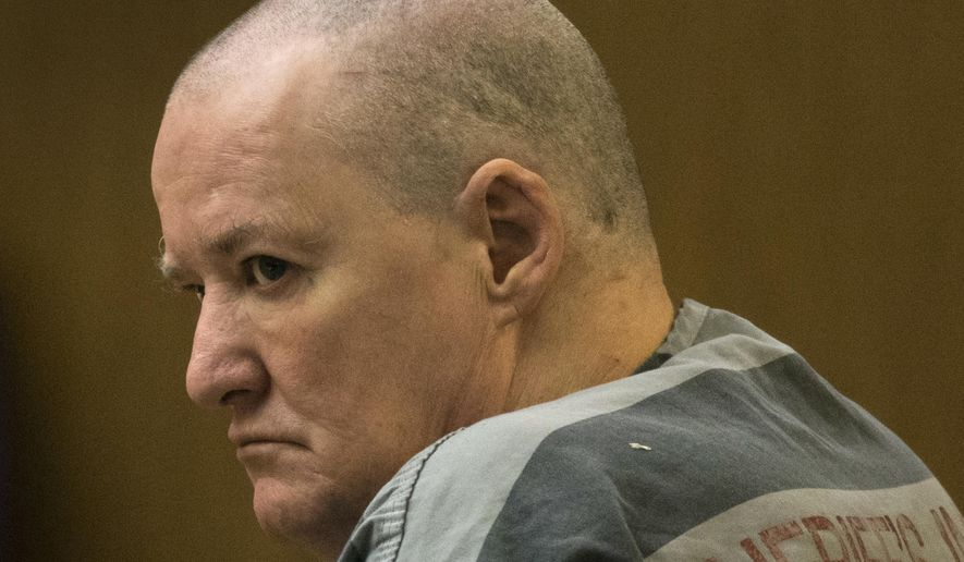 Gary Moran listens to his sentencing in Maricopa County Superior Court, Friday, April 7, 2017, in Phoenix. The homeless ex-convict was spared the death penalty Friday and sentenced to life in prison for killing a Catholic priest nearly three years ago with another priest's gun at a Phoenix church and beating another clergyman with a metal rod. (Mark Henle /The Arizona Republic via AP)