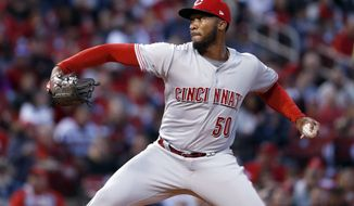 Cincinnati Reds starting pitcher Amir Garrett throws during the first inning of the team's baseball game against the St. Louis Cardinals Friday, April 7, 2017, in St. Louis. (AP Photo/Jeff Roberson)