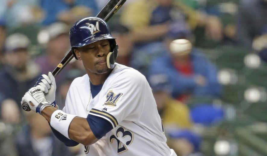 Milwaukee Brewers' Keon Broxton gets hit in the helmet by Colorado Rockies starting pitcher Antonio Senzatela in the second inning of a baseball game Thursday, April 6, 2017, in Milwaukee. Broxton left the game after the injury. (AP Photo/Jeffrey Phelps)