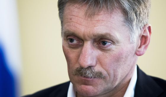 "In this photo taken on Thursday, April 6, 2017, President Vladimir Putin's spokesman Dmitry Peskov speaks with The Associated Press in Moscow, Russia in Moscow, Russia. ""President (Vladimir) Putin believes that the U.S. strikes on Syria represent an aggression against a sovereign state in violation of international law under a far-fetched pretext,"" Putin's spokesman Dmitry Peskov said in a statement. ""Washington's move deals a significant blow to the Russia-U.S. relations, which are already in a deplorable shape."" (AP Photo/Pavel Golovkin)."