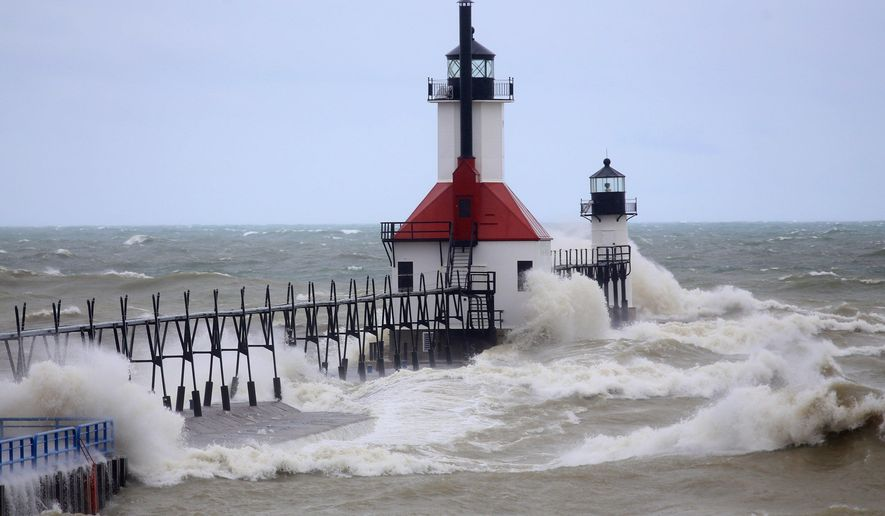 Large waves churn up the Lake Michigan surf at Benton Harbor and St. Joseph in Michigan, Thursday, April 6, 2017. A mix of snow and rain across much of Michigan is causing hazardous driving conditions and bringing the threat of flooding in places. (Mark Bugnaski/Kalamazoo Gazette-MLive Media Group via AP)