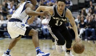 San Antonio Spurs guard Bryn Forbes (11) drives against Dallas Mavericks guard Yogi Ferrell during the second half of an NBA basketball game in Dallas, Friday, April 7, 2017. (AP Photo/LM Otero)