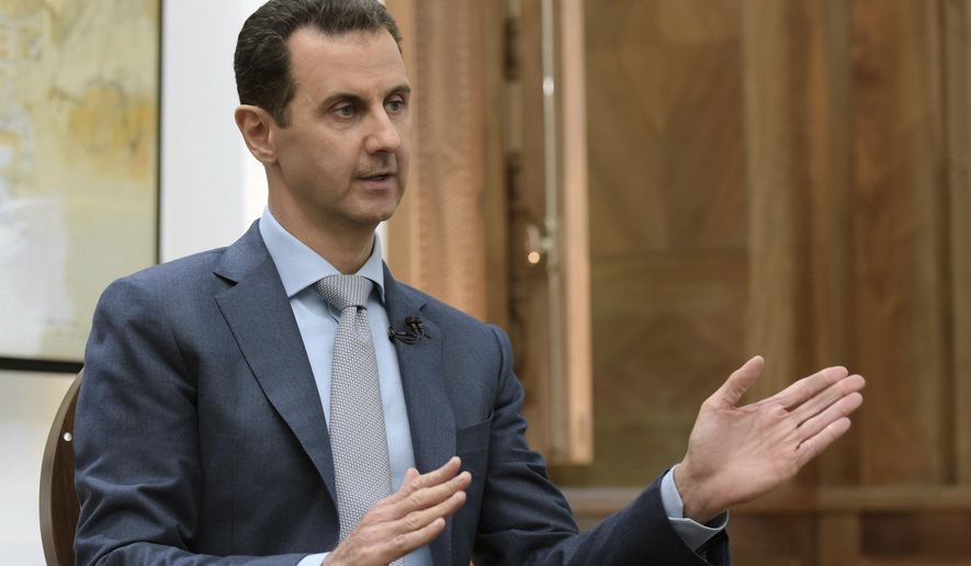 "FILE - In this Feb. 10, 2017 file photo released by the Syrian official news agency SANA, Syrian President Bashar Assad speaks during an interview with Yahoo News in Damascus, Syria. Syria decried a U.S. missile strike early Friday, April 7, 2017 on a government-controlled air base where U.S. officials say the Syrian military launched a deadly chemical attack earlier this week. Syria called the operation ""an aggression"" that killed at least six people.  (SANA via AP, File)"