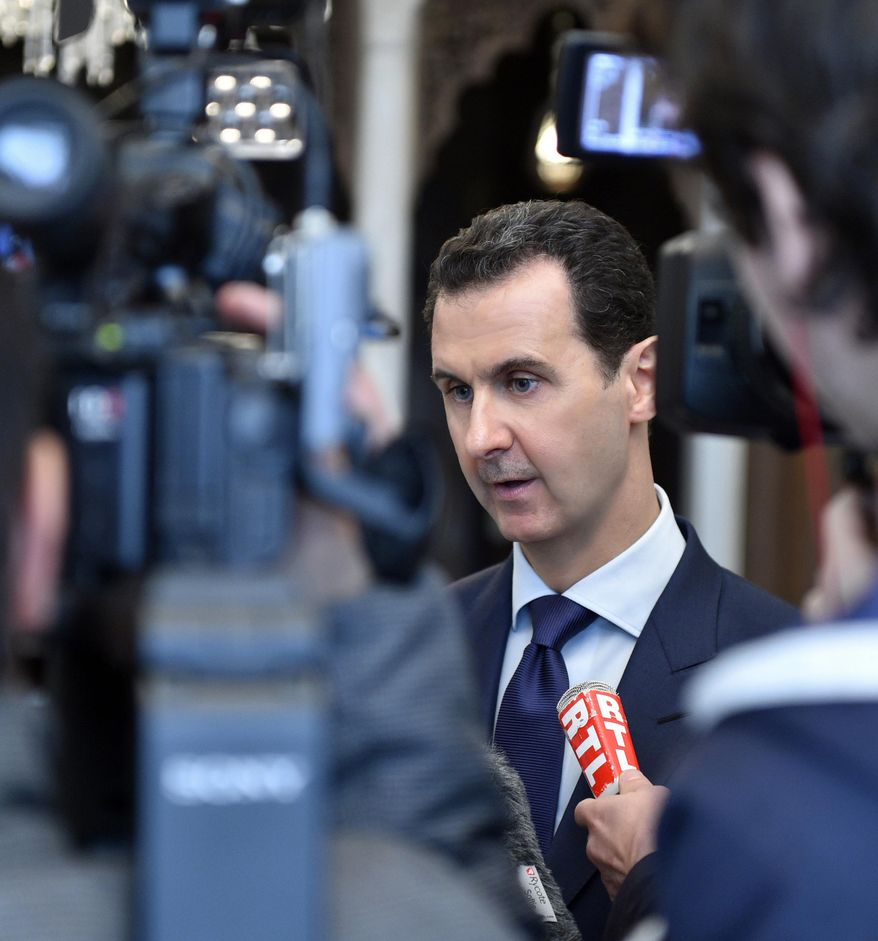"FILE - In this file photo released Monday, Jan. 9, 2017 by the Syrian official news agency SANA, Syrian President Bashar Assad, left, speaks with French journalists in Damascus, Syria. Syria decried a U.S. missile strike early Friday, April 7, 2017 on a government-controlled air base where U.S. officials say the Syrian military launched a deadly chemical attack earlier this week. Syria called the operation ""an aggression"" that killed at least six people.  (SANA via AP, File)"